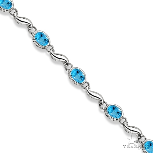 Bezel-Set Oval Blue Topaz Bracelet in 14K White Gold (7x5 mm) Gemstone & Pearl