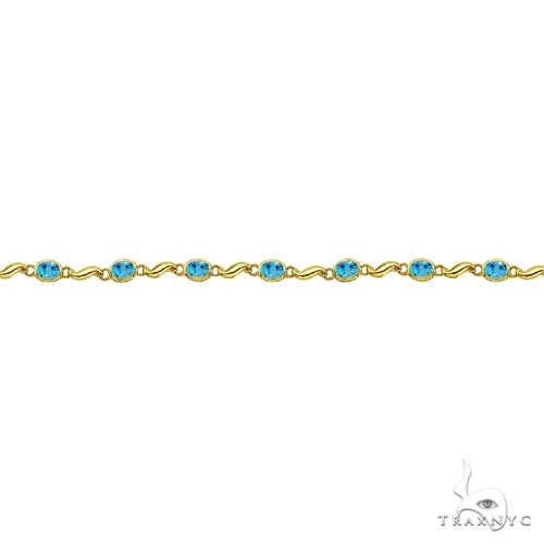Bezel-Set Oval Blue Topaz Bracelet in 14K Yellow Gold (7x5 mm) Gemstone & Pearl