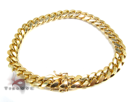 Miami Cuban Link Bracelet 8 Inches 7 mm 30.0 Grams 32504 Gold